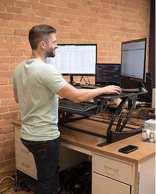Jonathon working at a standing desk